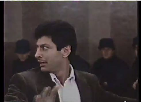 Looking to the right and pointing forward Goldblum (no glasses)