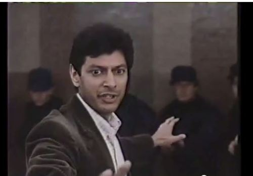 Pointing forward Goldblum (no glasses)