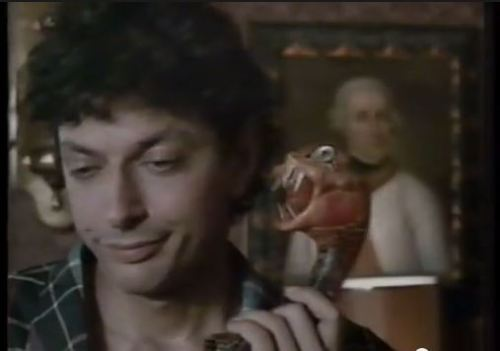 Reluctantly talking on snake phone Goldblum
